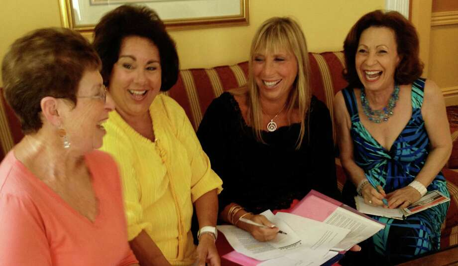 Members of the Westport Woman's Club plan events for the 2013-2014 season including a new member wine and cheese event  Sept. 30. From left, Leah Scherzer, Shirlee Gordon, Cathie Hurwitz and Vivian Rosenberg. Photo: Contributed Photo / Westport News