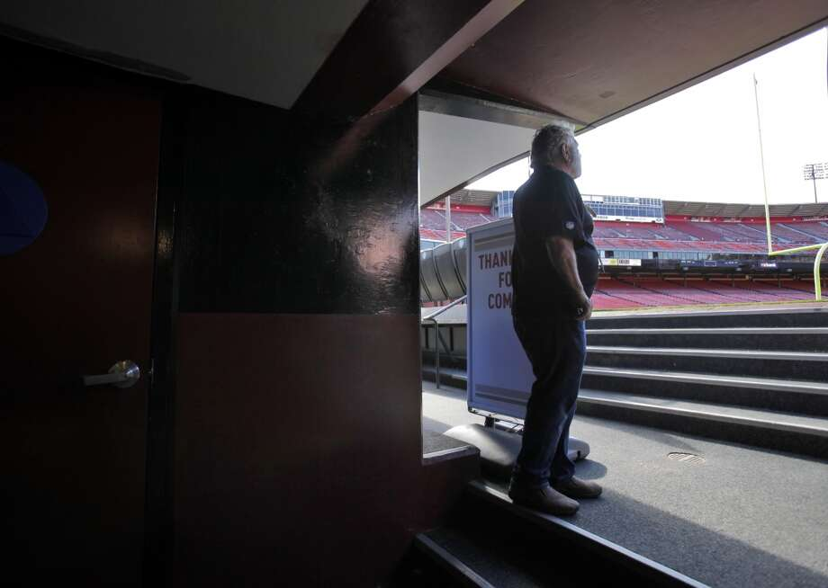 Bob Mallamo looks out from the team tunnel out onto the Bill Walsh Field at Candlestick Park. Photo: Carlos Avila Gonzalez, The Chronicle