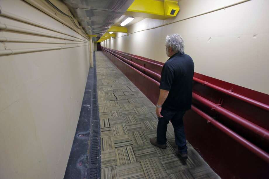 Bob Mallamo walks through the home team tunnel that hundreds of players for the Giants and 49ers used to come to the field. Photo: Carlos Avila Gonzalez, The Chronicle