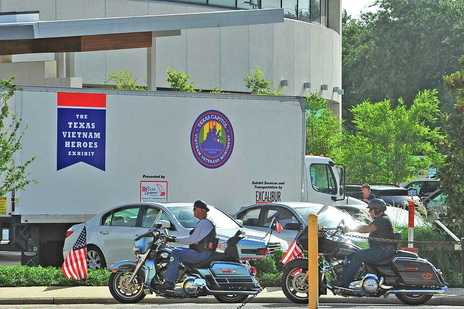Members of the Patriot Guard Riders and others pull up near the Edison Plaza behind the truck they escorted since Winnie where the Houston Patriot Guard handed it off to them.  Monday morning, the dog tags of 3417 Texas combat veterans, who died or are missing in action, during the Vietnam War, arrived in Beaumont escorted by the Patriot Guard Riders, Vietnam Veteran motorcyclists, the Jeeper Cub and others.  The The Texas Vietnam Heroes Exhibit will be housed in the lobby of the Edison Plaza for three weeks starting on Wednesday when it will open to the public at 10 am. Dave Ryan/The Enterprise Photo: Dave Ryan