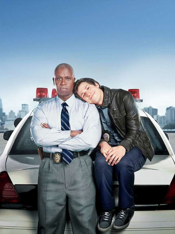 Emmy Award winners Andre Braugher (L) and Andy Samberg (R) star in BROOKLYN NINE-NINE, a new single-camera workplace comedy about what happens when a hotshot detective (Samberg) gets a new Captain (Braugher) with a lot to prove. Photo: Matt Hoyle