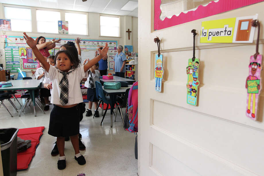 Amistad Abundis, 4, sings nursery rhymes with her Pre-Kinder 4 classmates at Good Shepherd Catholic Academy. Photo: Jerry Lara, San Antonio Express-News / © 2013 San Antonio Express-News