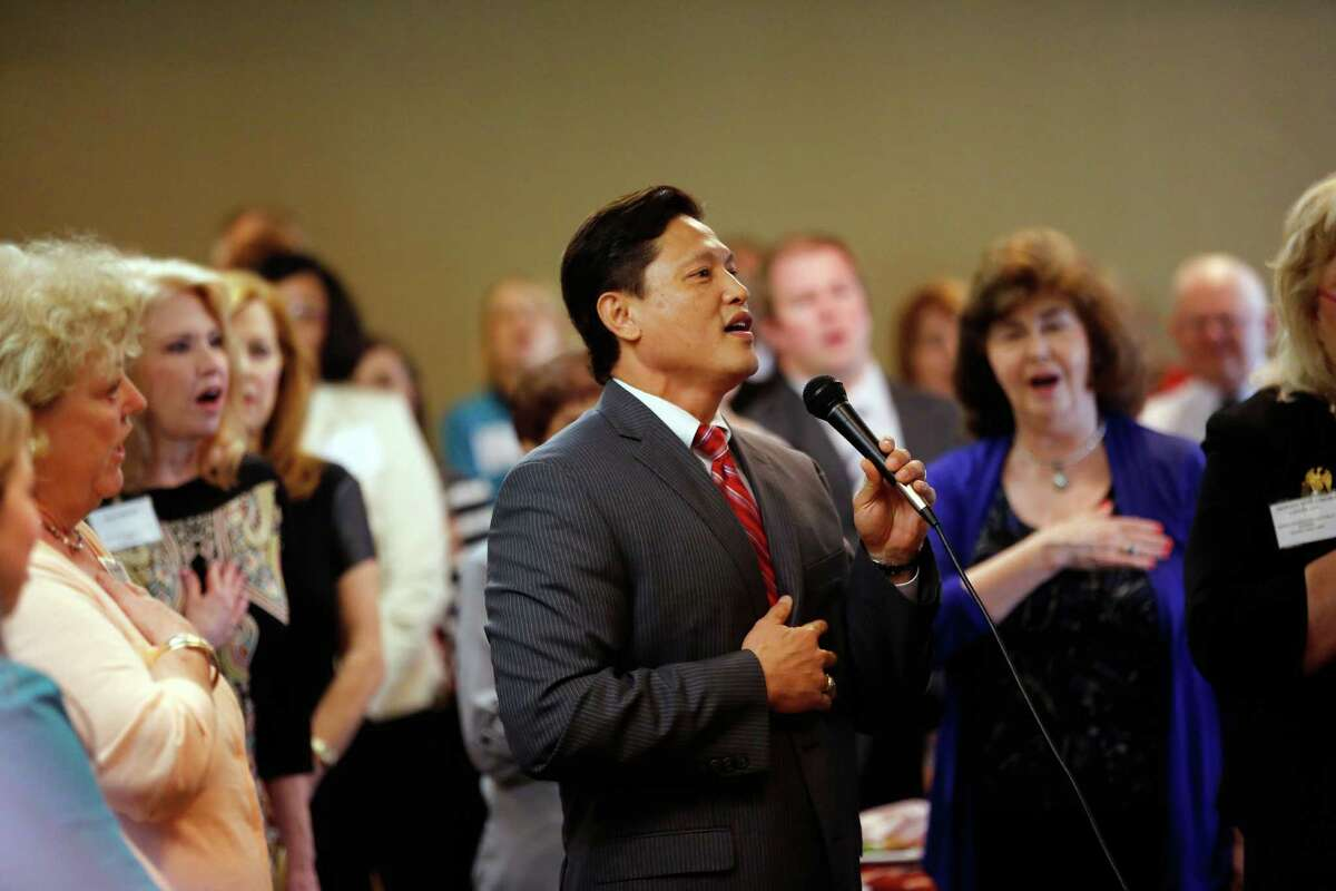 Danny Nguyen leads the Republican women in the singing of the national anthem during a debate between the four candidates for lieutenant governor, Monday, September 16, 2013 at the Republican's women's forum at the Doubletree hotel in Houston, Texas.