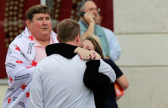 A man and woman embrace while reuniting at a gathering point for family members of Navy Yard employees that was set up inside Nationals Park in the wake of the shooting September 16, 2013 in Washington, DC. Police believe at least one gunman shot and killed at least 12 people and wounded others in an incident that put parts of the city on lockdown. Photo: Win McNamee, Getty Images