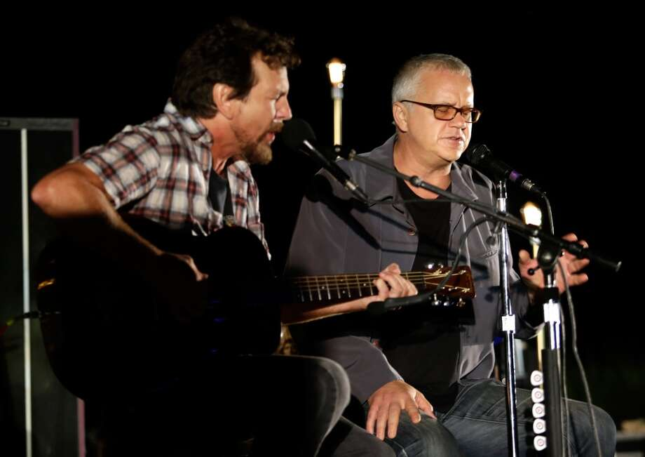 Eddie Vedder and Tim Robbins peform onstage during Eddie Vedder and Zach Galifianakis Rock Malibu Fundraiser for EBMRF and Heal EB on September 15, 2013 in Malibu, California.  (Photo by Jeff Vespa/WireImage) Photo: Jeff Vespa, WireImage