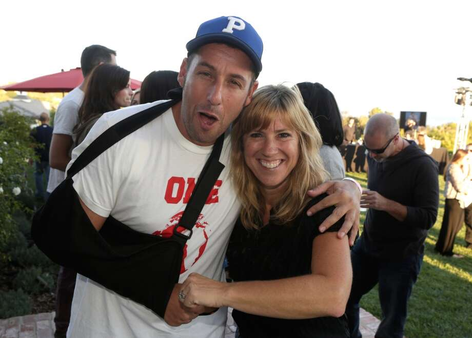 Adam Sandler and Andrea Pett-Joseph attend Eddie Vedder and Zach Galifianakis Rock Malibu Fundraiser for EBMRF and Heal EB on September 15, 2013 in Malibu, California.  (Photo by Jeff Vespa/WireImage) Photo: Jeff Vespa, WireImage