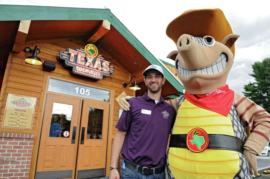 Texas Roadhouse. 105 Wolf Rd., Colonie.Corporate trainer Cannon Mentzer and mascot Andy the Armadillo welcome people at the entrance to the Texas Roadhouse restaurant which had their grand opening on Monday, Sept. 16, 2013 in Colonie, N.Y. (Lori Van Buren / Times Union) Photo: Lori Van Buren / 00023884A
