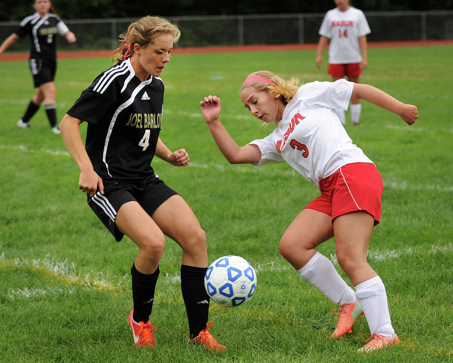 Joel Barlow's Grace Blackwell, left, converges on the ball with Masuk's Lydia Michols during Barlow's 1-0 girls soccer victory at Masuk High School in Monroe, Conn. on Monday, September 16, 2013. Photo: Brian A. Pounds / Connecticut Post