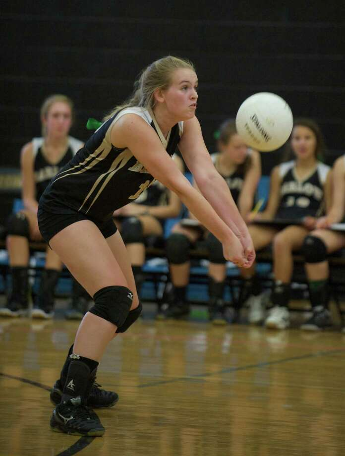 Joel Barlow's Hayley Stilson, 15, returns a serve during a girls volleyball game against Newtown High School at Joel Barlow High School in Redding, Conn, on Monday, September 16, 2013. Photo: H John Voorhees III