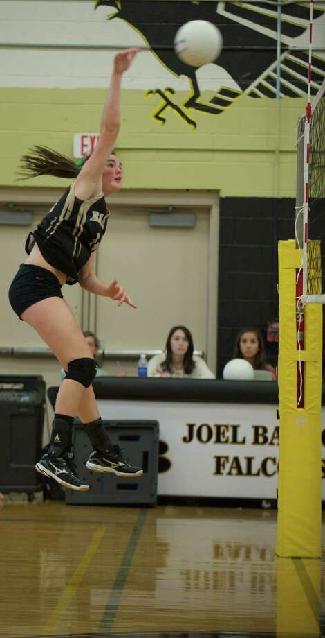 Joel Barlow's Allie Grimes, 14, spikes the ball during a girls volleyball game against Newtown High School at Joel Barlow High School in Redding, Conn, on Monday, September 16, 2013. Photo: H John Voorhees III