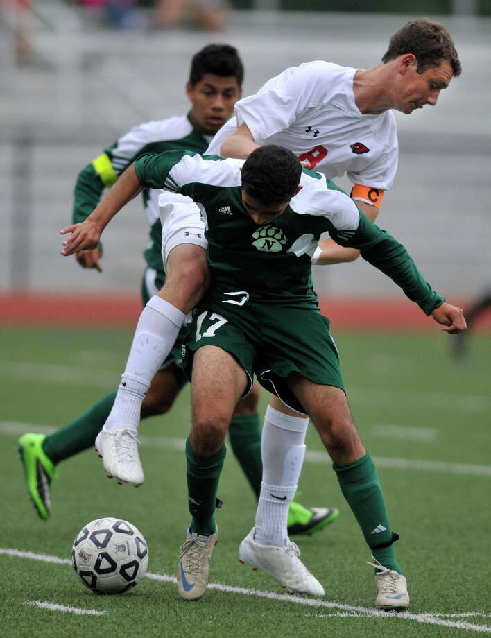 Greenwich's Jonathan Palmer and Norwalk's Rene Jimenez collide during their game at Greenwich High School in Greenwich, Conn., on Monday, Sept. 16, 2013. Greenwich beat Norwalk, 3-0. Photo: Jason Rearick / Stamford Advocate