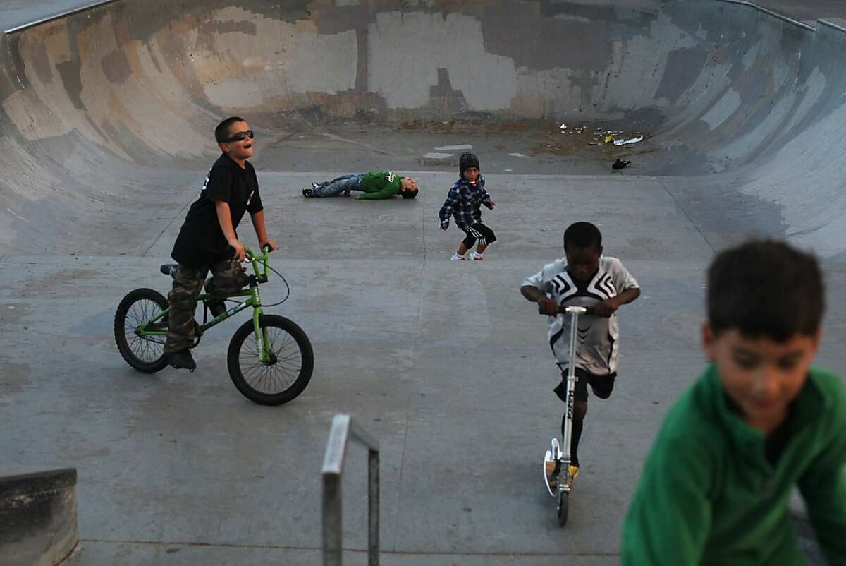 Mike, (left-right), Jason, Vicente, Christopher and Benji prepare to leave a skatepark in between Crocker Amazon Playground and John McLaren Park on September 14, 2013 in San Francisco, Calif.
