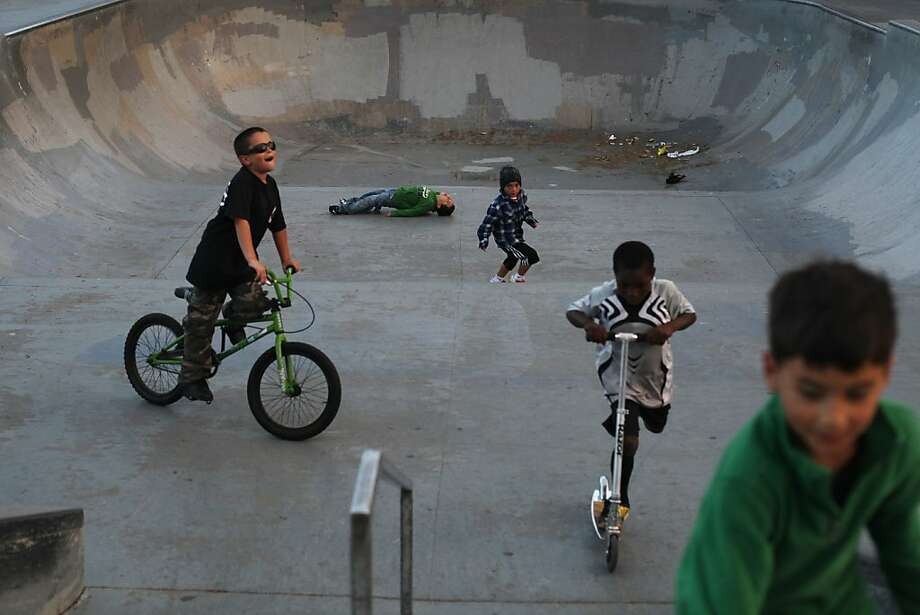 Mike (left), Jason, Vicente, Christopher and Benji ride through the skate area near McLaren Park. Photo: Pete Kiehart, The Chronicle