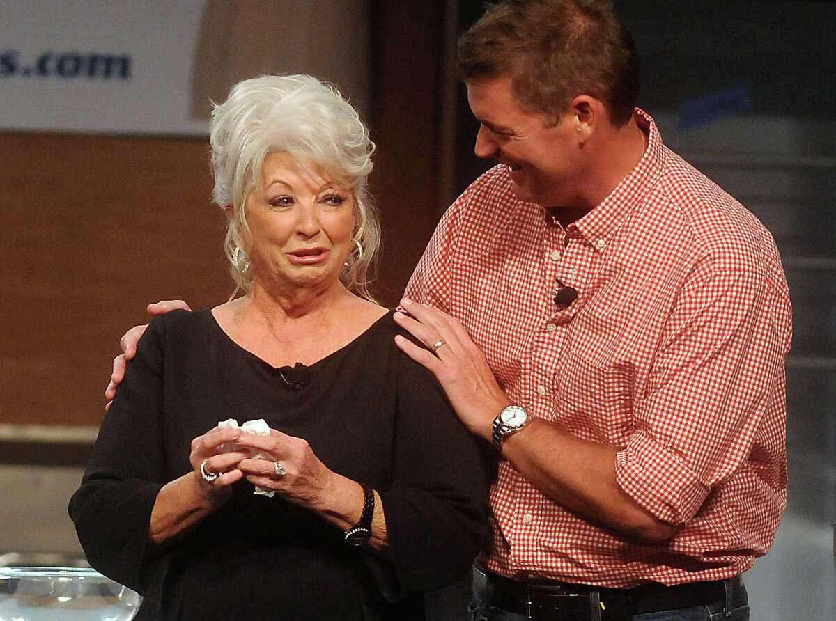Chef Paula Deen is consoled by her son Jamie after taking the stage at the Metropolitan Cooking & Entertaining Show at the Reliant Center Saturday Sept. 14 2013.