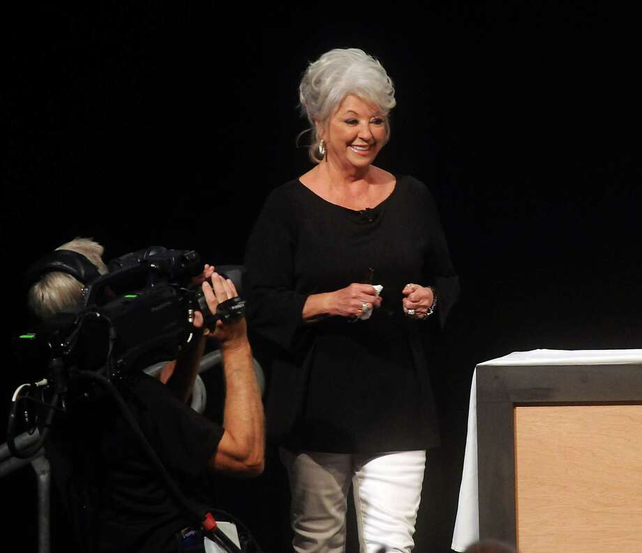 Chef Paula Deen arrives on stage at the Metropolitan Cooking & Entertaining Show at the Reliant Center Saturday Sept. 14 2013. Photo: Dave Rossman, For The Houston Chronicle / © 2013 Dave Rossman