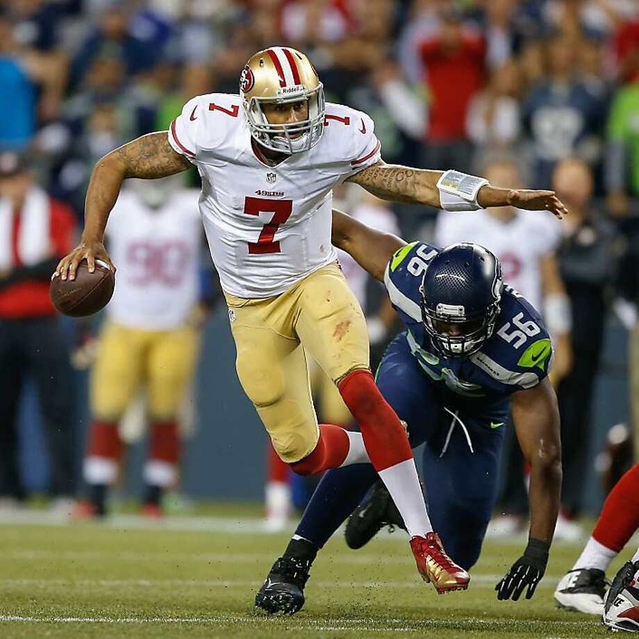 SEATTLE, WA - SEPTEMBER 15:  Quarterback Colin Kaepernick #7 of the San Francisco 49ers rushes against defensive end Cliff Avril #56 of the Seattle Seahawks at CenturyLink Field on September 15, 2013 in Seattle, Washington. The Seahawks defeated the 49ers 29-3.  (Photo by Otto Greule Jr/Getty Images) Photo: Otto Greule Jr, Getty Images