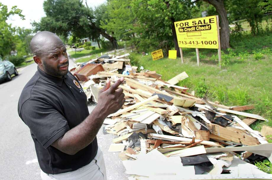 Jerry Davis is city councilman for District B, where he and former Mayor Annise Parker launched a three-month project to identify, apprehend and prosecute illegal dumpers by using five video surveillance cameras. Photo: Mayra Beltran, Staff / © 2013 Houston Chronicle