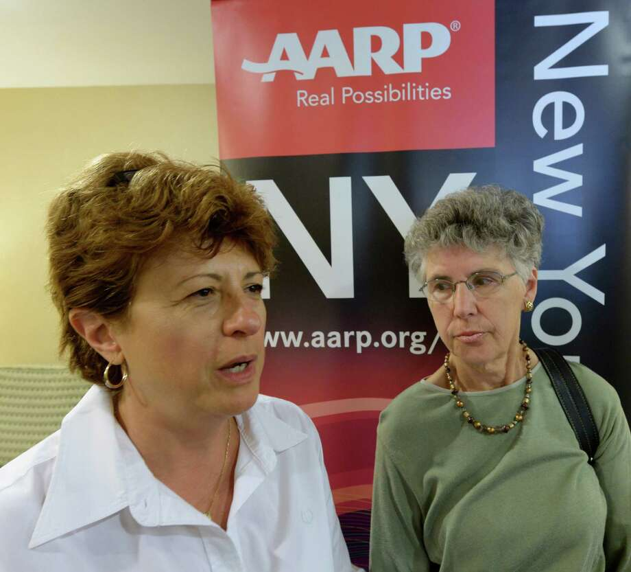 Caregivers Lynn Christie, right and Anne Marie Cuff speak to the Times Union at an AARP symposium on caregiving Sept 16, 2013 at the Hilton Garden Inn in Albany , N.Y.   (Skip Dickstein/Times Union) Photo: SKIP DICKSTEIN / 00023683A