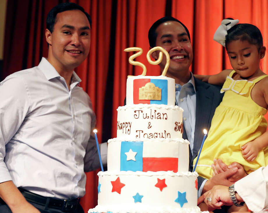 U.S. Rep. Joaquín Castro, D-San Antonio, (left) and twin brother Mayor Julián Castro with his daughter Carina, 4,   celebrate the twins' 39th birthdays Monday Sept. 16, 2013 at the Pearl Stable. Photo: Edward A. Ornelas, San Antonio Express-News / © 2012 San Antonio Express-News