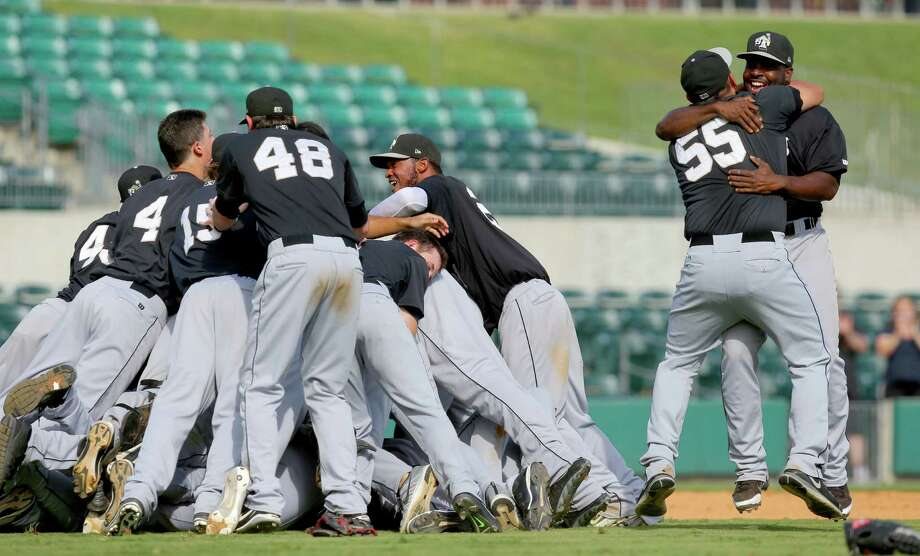 Missions players enjoy a dogpile in celebration of their 5-0 victory in the decisive Game 5 of the Texas League Championship Series on Sunday at Arkansas. Photo: Stephen B. Thornton / Arkansas Democrat-Gazette