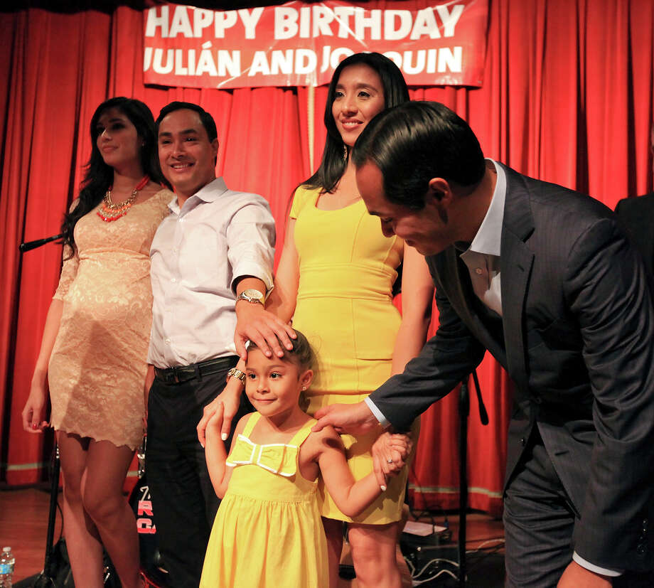 Joaquín Castro's fiancee Anna Flores (from left), U.S. Rep. Joaquín Castro, D-San Antonio, Julián Castro's wife Erica and daughter Carina, and Mayor Julián Castro celebrate the twins 39th birthdays Monday Sept. 16, 2013 at the Pearl Stable. Photo: Edward A. Ornelas, San Antonio Express-News / © 2012 San Antonio Express-News