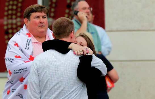 A man and woman embrace while reuniting at a gathering point for family members of Navy Yard employees that was set up inside Nationals Park in the wake of the shooting September 16, 2013 in Washington, DC. Police believe at least one gunman shot and killed at least 12 people and wounded others in an incident that put parts of the city on lockdown. Photo: Win McNamee, Getty Images / 2013 Getty Images