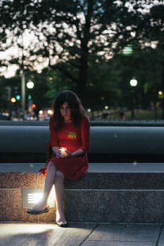 Nichole Goble of Washington, D.C. holds a candle to remember victims of gun violence during a vigil at Freedom Plaza on September 16, 2013 in Washington, DC.  The vigil, during which organizers called for stricter gun laws, was in remembrance of the 12 victims killed in a shooting at the Washington Navy Yard earlier in the day. Photo: Greg Kahn, Getty Images / 2013 Getty Images