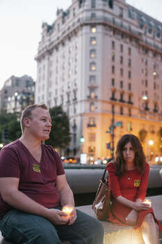 Paul Mills of Silver Spring, MD, and Nichole Goble of Washington, D.C. hold candles to remember victims of gun violence during a vigil at Freedom Plaza on September 16, 2013 in Washington, DC.  The vigil, during which organizers called for stricter gun laws, was in remembrance of the 12 victims killed in a shooting at the Washington Navy Yard earlier in the day. Photo: Greg Kahn, Getty Images / 2013 Getty Images