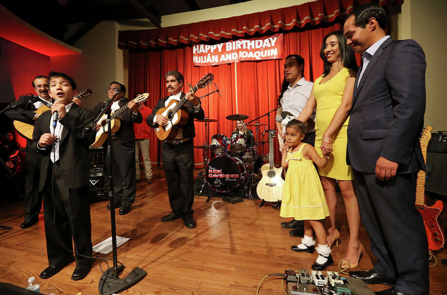 Sebastien De La Cruz (from left) performs as Joaquín Castro's fiancee Anna Flores, U.S. Rep. Joaquín Castro, D-San Antonio, Julián Castro's wife Erica and daughter Carina, 4, and Mayor Julian Castro celebrate the twins' 39th birthdays Monday Sept. 16, 2013 at the Pearl Stable. Photo: Edward A. Ornelas, San Antonio Express-News / © 2012 San Antonio Express-News