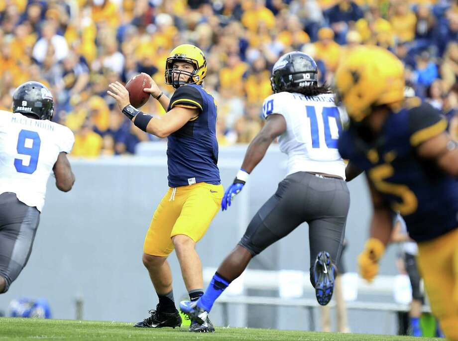 West Virginia quarterback Ford Childress, in his first collegiate start, torched Georgia State for 359 yards and three touchdowns in a 41-7 victory. He's the son of ex-A&M end Ray Childress. Photo: Chris Jackson / Associated Press