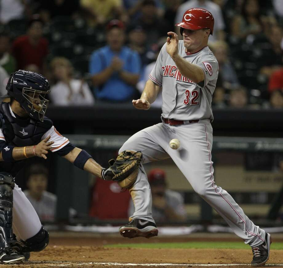 Jay Bruce of the Reds scores a run against the Astros. Photo: Melissa Phillip, Houston Chronicle