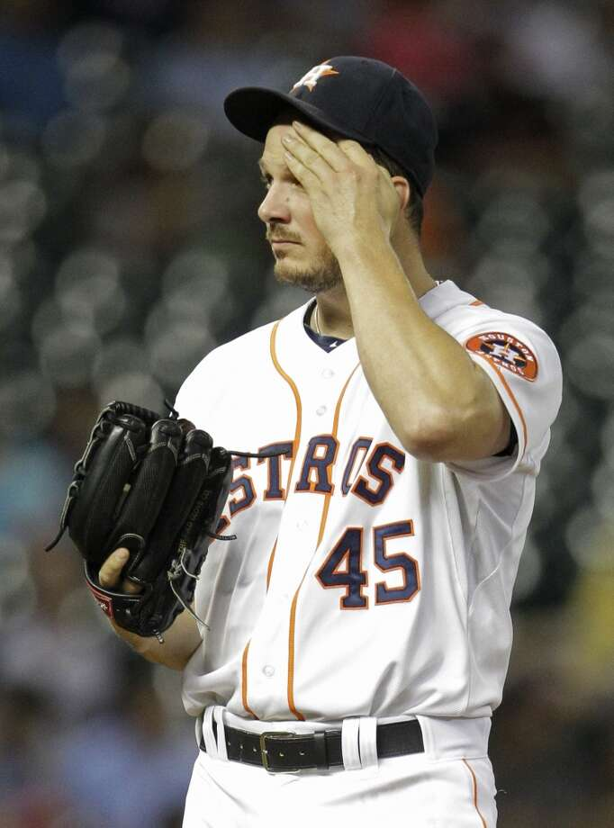 Astros pitcher Erik Bedard reacts after giving up a home run to the Reds. Photo: Melissa Phillip, Houston Chronicle