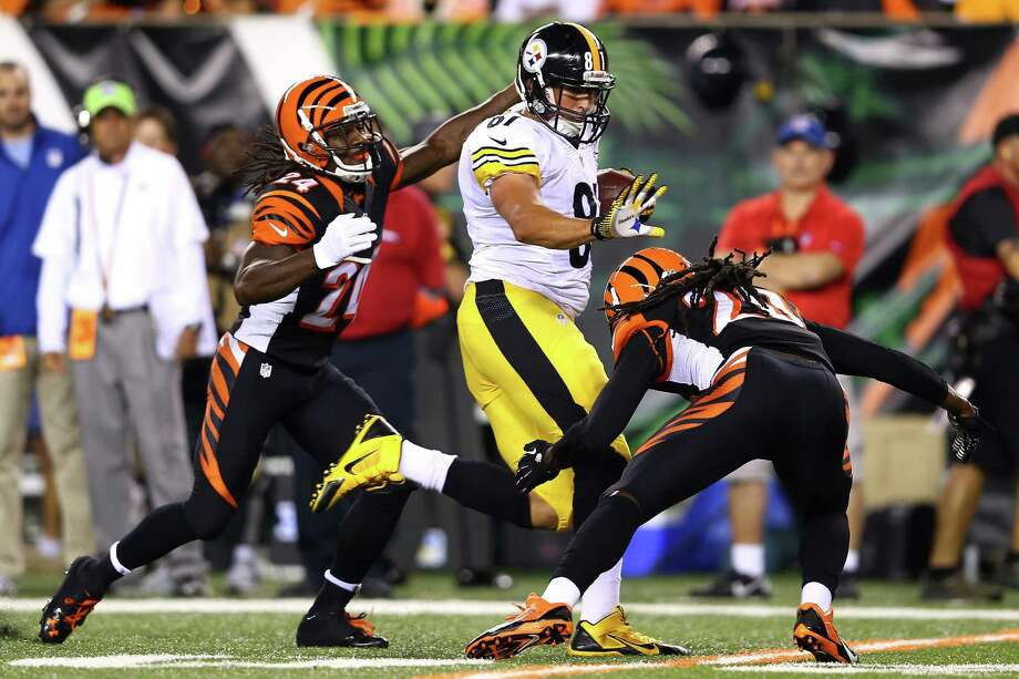 CINCINNATI, OH - SEPTEMBER 16:  Tight end David Paulson #81 of the Pittsburgh Steelers runs after a catch before cornerback Adam Jones #24 of the Cincinnati Bengals strips the ball causing a fumble in the first quarter at Paul Brown Stadium on September 16, 2013 in Cincinnati, Ohio.  (Photo by Andy Lyons/Getty Images) ORG XMIT: 175878210 Photo: Andy Lyons / 2013 Getty Images