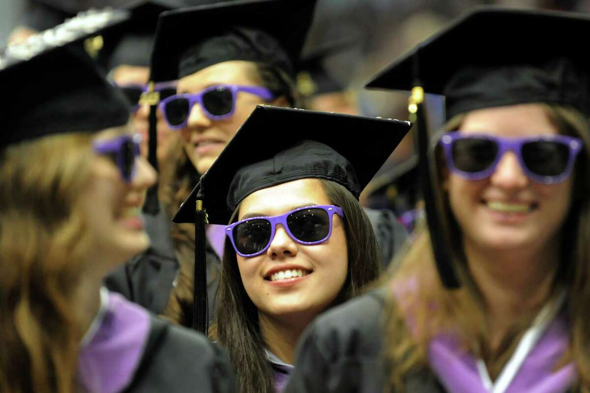 Graduate Sarah Goldfarb, center, wears sunglasses to show solidarity with fellow architectural graduates during RPI college commencement on Saturday, May 25, 2013, at Rensselaer Polytechnic Institute in Troy, N.Y. (Cindy Schultz / Times Union)