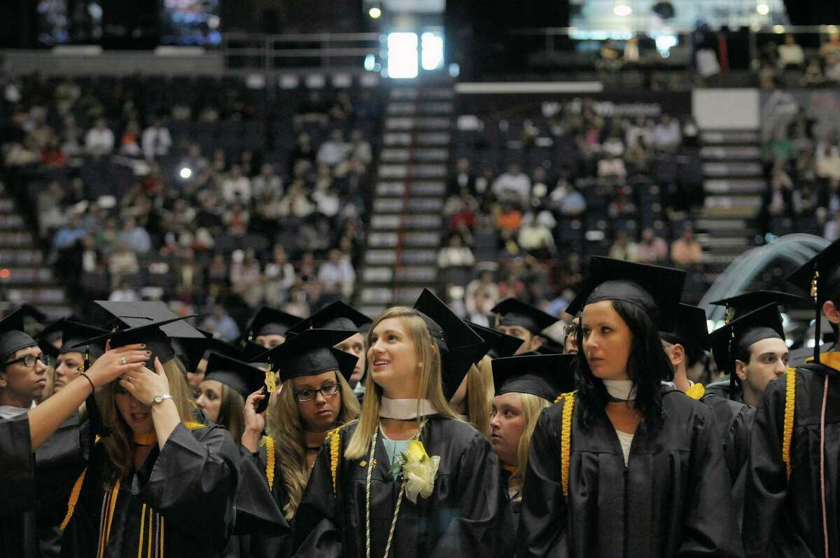 Graduates scan the crowd for family and friends after processing in during the college commencement ceremony for Siena College at the Times Union Center on Sunday, May 19, 2013 in Albany, NY. (Paul Buckowski / Times Union)