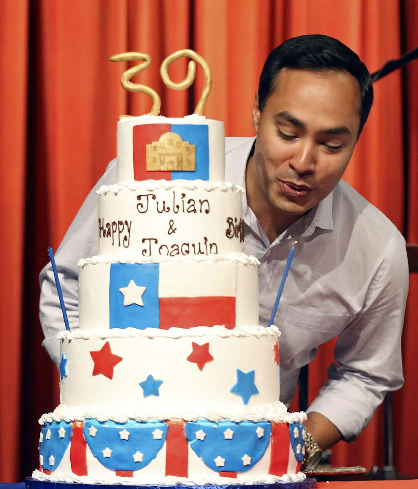 Joaquín Castro blows out a candle on a giant birthday cake for him and brother Julián on Monday Sept. 16, 2013, at the Pearl Stable
