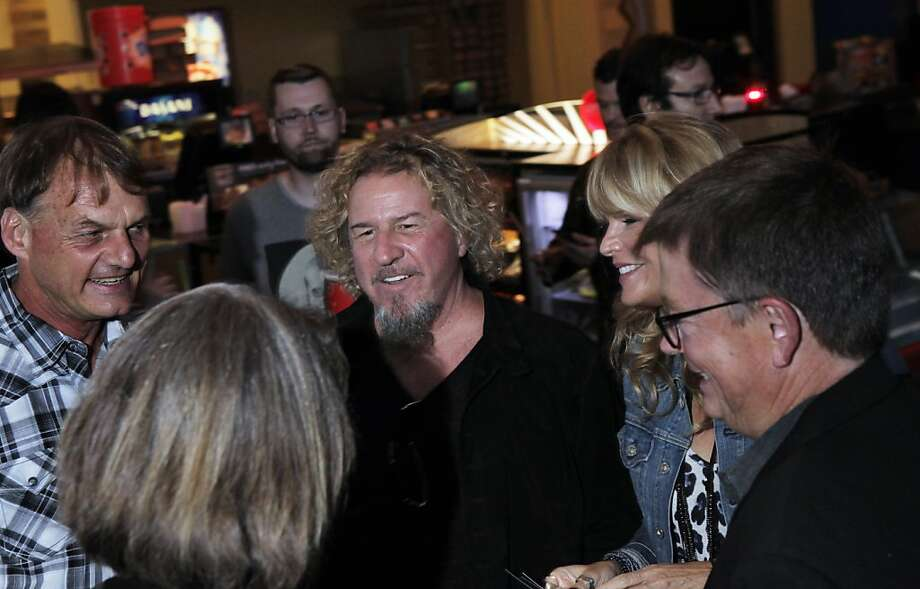 """Rocker Sammy Hagar chats with other attendees as he and members of the band Metallica attended the U.S. premiere of the movie, """"Metallica Through the Never,"""" at the Metreon Theater in San Francisco, Calif., on Monday, September 16, 2013. Photo: Carlos Avila Gonzalez, The Chronicle"""
