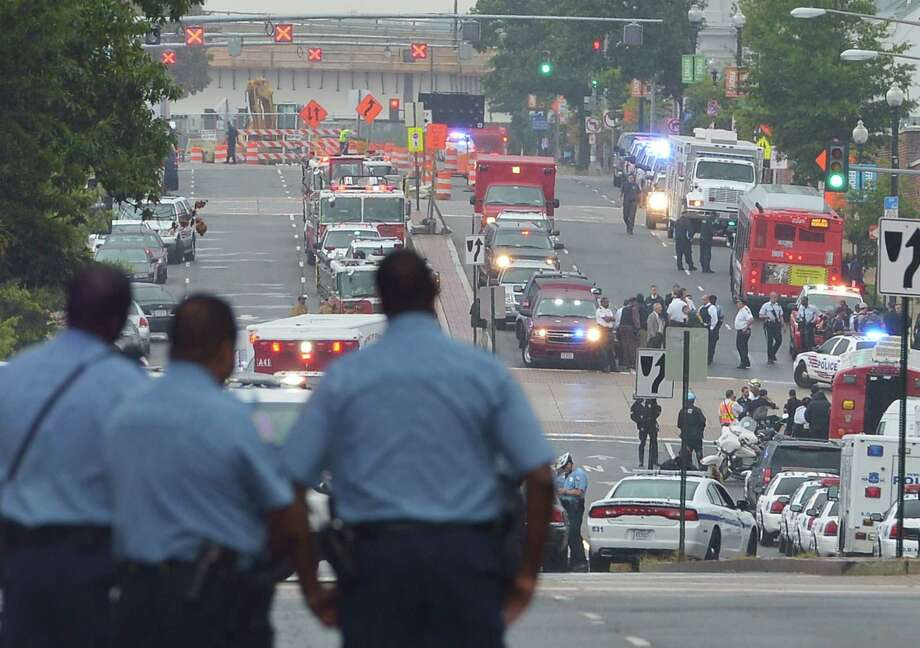 M Street near the Washington Navy Yard is full of police and first-responder activity reacting to a suspect killing a dozen people and wounding others. Troops stood guard at street corners. Photo: Mandel Ngan / AFP / Getty Images