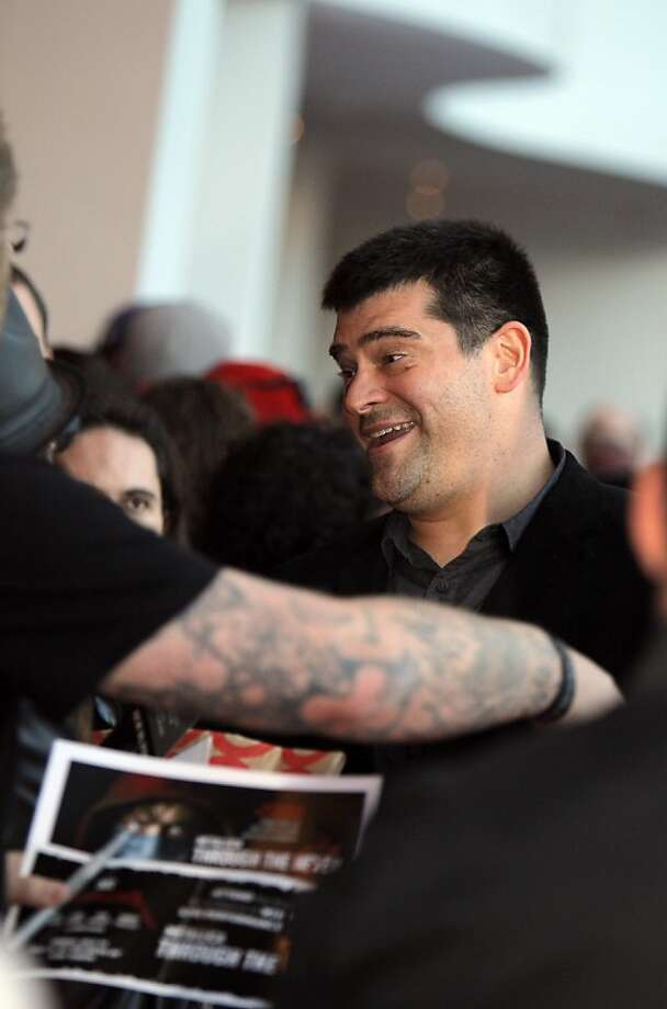 "Director Nimrod Antal signs autographs as he and members of the band Metallica attended the U.S. premiere of the movie, ""Metallica Through the Never,"" at the Metreon Theater in San Francisco, Calif., on Monday, September 16, 2013. Photo: Carlos Avila Gonzalez, The Chronicle"