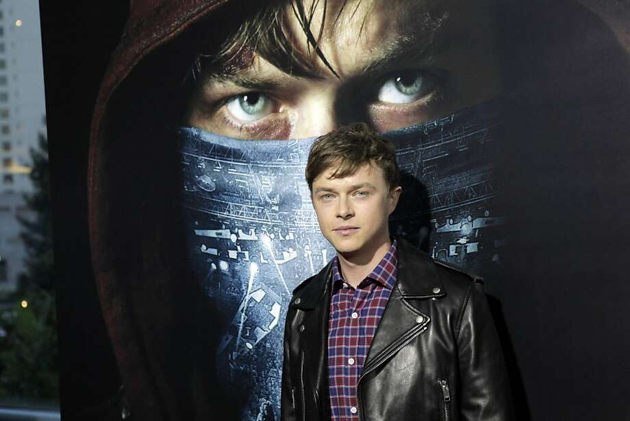 "Dane DeHaan poses for photos on the red carpet as he and members of the band Metallica attended the U.S. premiere of the movie, ""Metallica Through the Never,"" at the Metreon Theater in San Francisco, Calif., on Monday, September 16, 2013. Photo: Carlos Avila Gonzalez, The Chronicle"