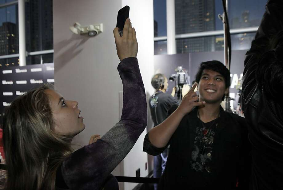 "Selina Schweitzer takes a photo of Brendon Escalona as members of the band Metallica walked the red carpet and attended the U.S. premiere of the movie, ""Metallica Through the Never,"" at the Metreon Theater in San Francisco, Calif., on Monday, September 16, 2013. Photo: Carlos Avila Gonzalez, The Chronicle"