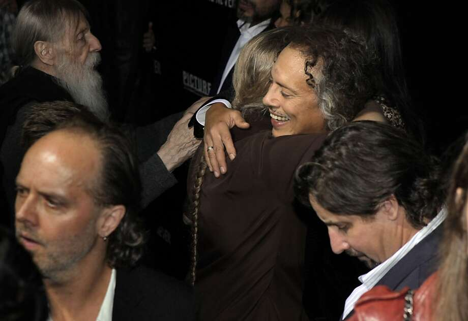 "Kirk Hammett gets a hug on the red carpet as he and members of the band Metallica attended the U.S. premiere of the movie, ""Metallica Through the Never,"" at the Metreon Theater in San Francisco, Calif., on Monday, September 16, 2013. Photo: Carlos Avila Gonzalez, The Chronicle"