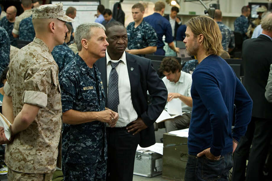 David Andrews as U.S. Navy Captain Mullenaro, briefing Fana Mokoena as Thierry Umutoni and Brad Pitt as Gerry Lane on the current worldwide zombie situation. Photo: Paramount, 2013