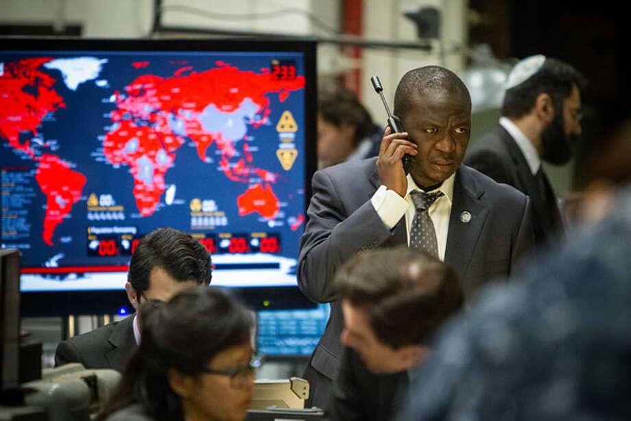 Fana Mokoena as Thierry Umutoni, on the phone with Lane. Photo: Paramount, 2013