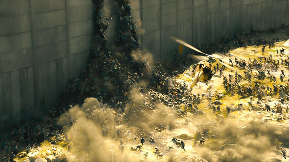 A horde of zombies band together to scale a wall outside Jerusalem in search of prey. Photo: Paramount, 2013