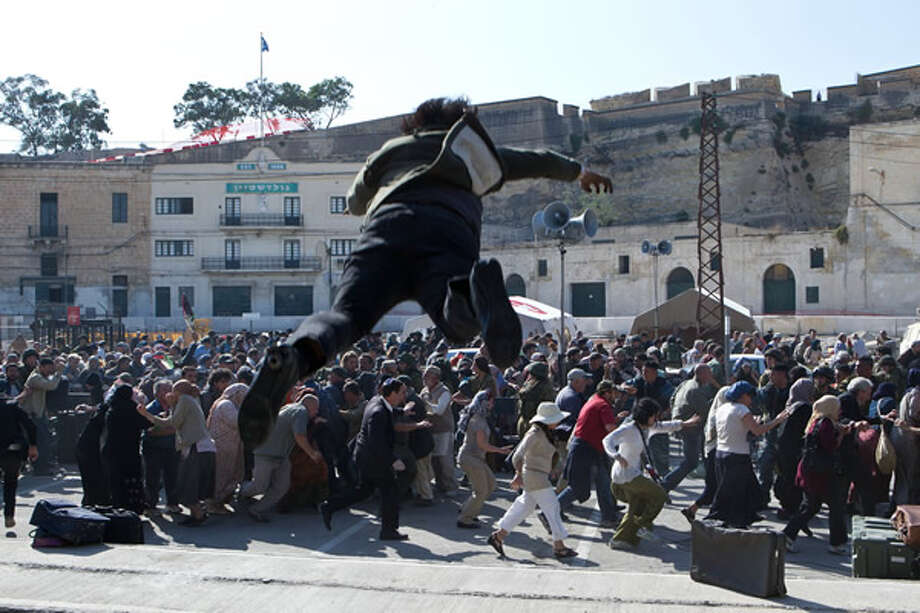 A zombie leaps out at a crowd of uninfected humans in Jerusalem. Photo: Paramount, 2013