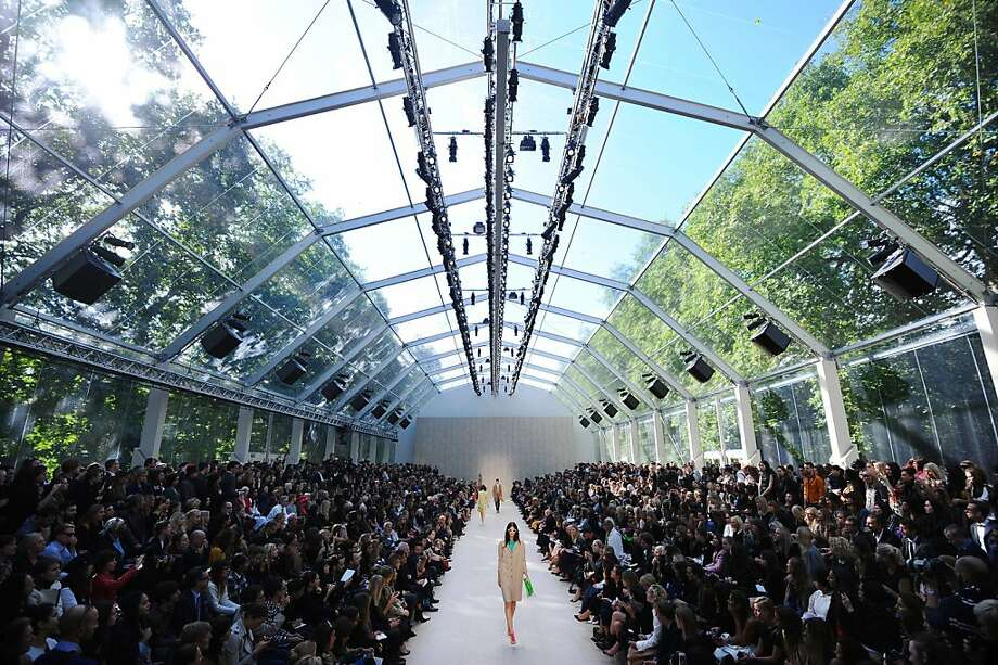 TOPSHOTS Models present creations by Burberry Prorsum during the 2014 Spring/Summer London Fashion Week in London on September 16, 2013. AFP PHOTO / BEN STANSALLBEN STANSALL/AFP/Getty Images Photo: Ben Stansall, AFP/Getty Images