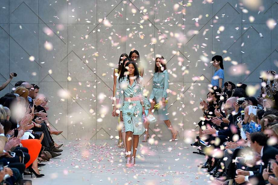 TOPSHOTS Modeld present creations by Burberry Prorsum during the 2014 Spring/Summer London Fashion Week in London on September 16, 2013. AFP PHOTO / BEN STANSALLBEN STANSALL/AFP/Getty Images Photo: Ben Stansall, AFP/Getty Images