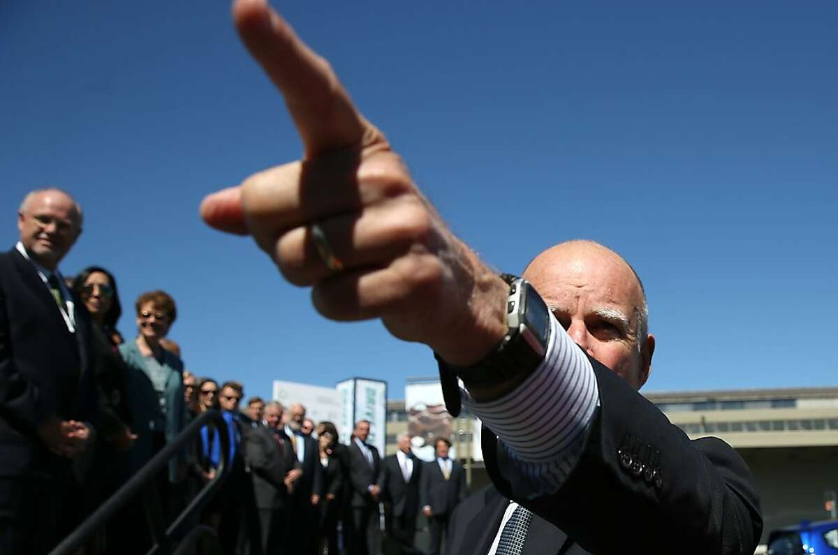 In this file photo, California Gov. Jerry Brown points as he walks on stage before speaking during the Drive The Dream event at the Exploratorium in San Francisco. California Gov. Jerry Brown met with California corporate leaders at Drive The Dream to discuss progress in the adoption of electric vehicles and workplace charging stations at businesses in the state.