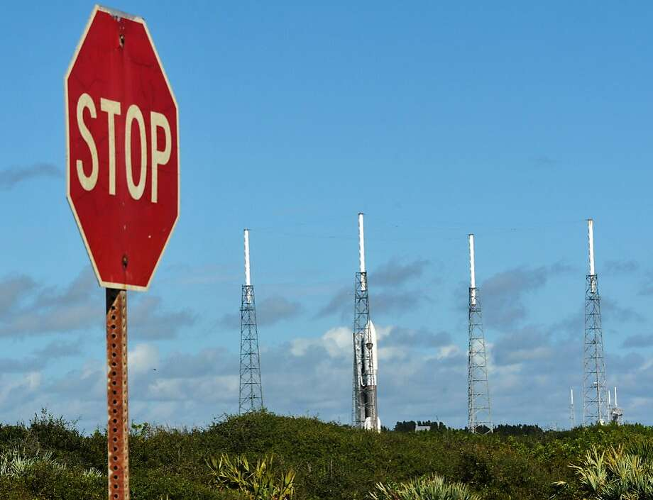 Cape Canaveral Air Force Station rollout the Atlas V rocket on Monday, Sept. 16, 2013, in Cape Canaveral, Fla. The rocket will carry an Air Force communications satellite, and is scheduled for launch at 3:04 a.m., on Wednesday.  (AP Photo/Florida Today, Time Shortt)  NO SALES Photo: Tim Shortt, Associated Press